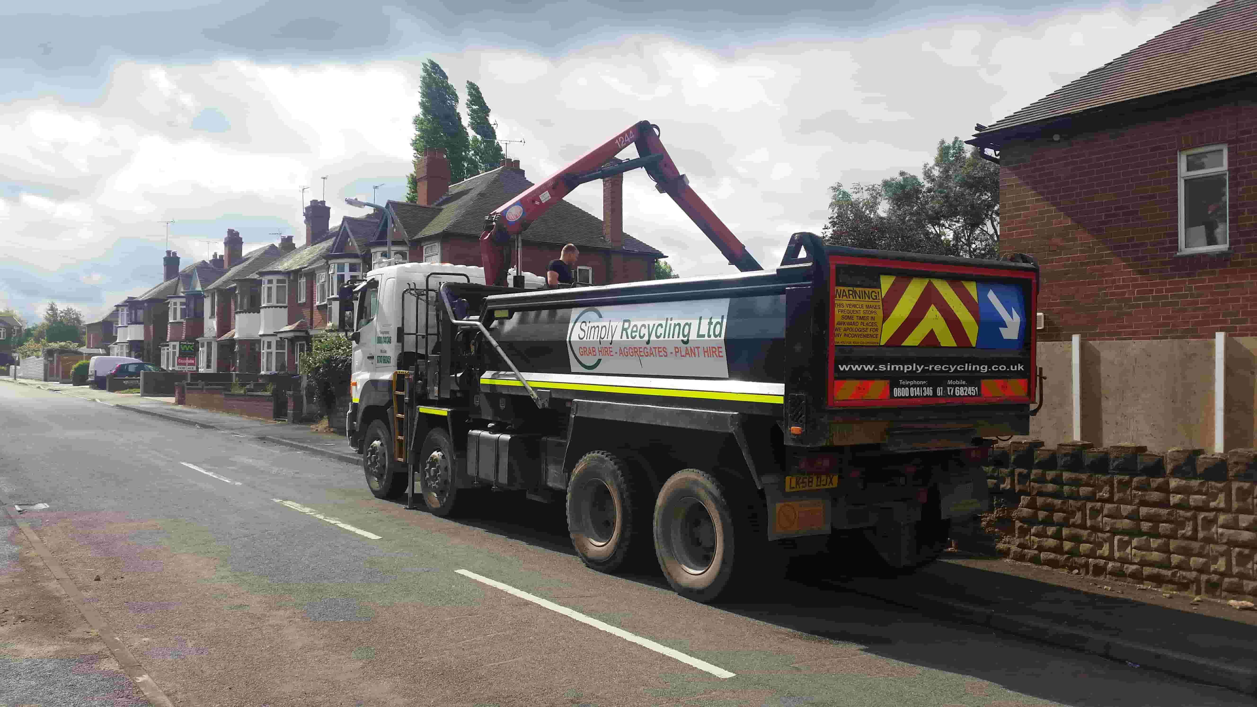 Photo of our grab lorry grabbing waste from a property in West Bromwich, West Midlands