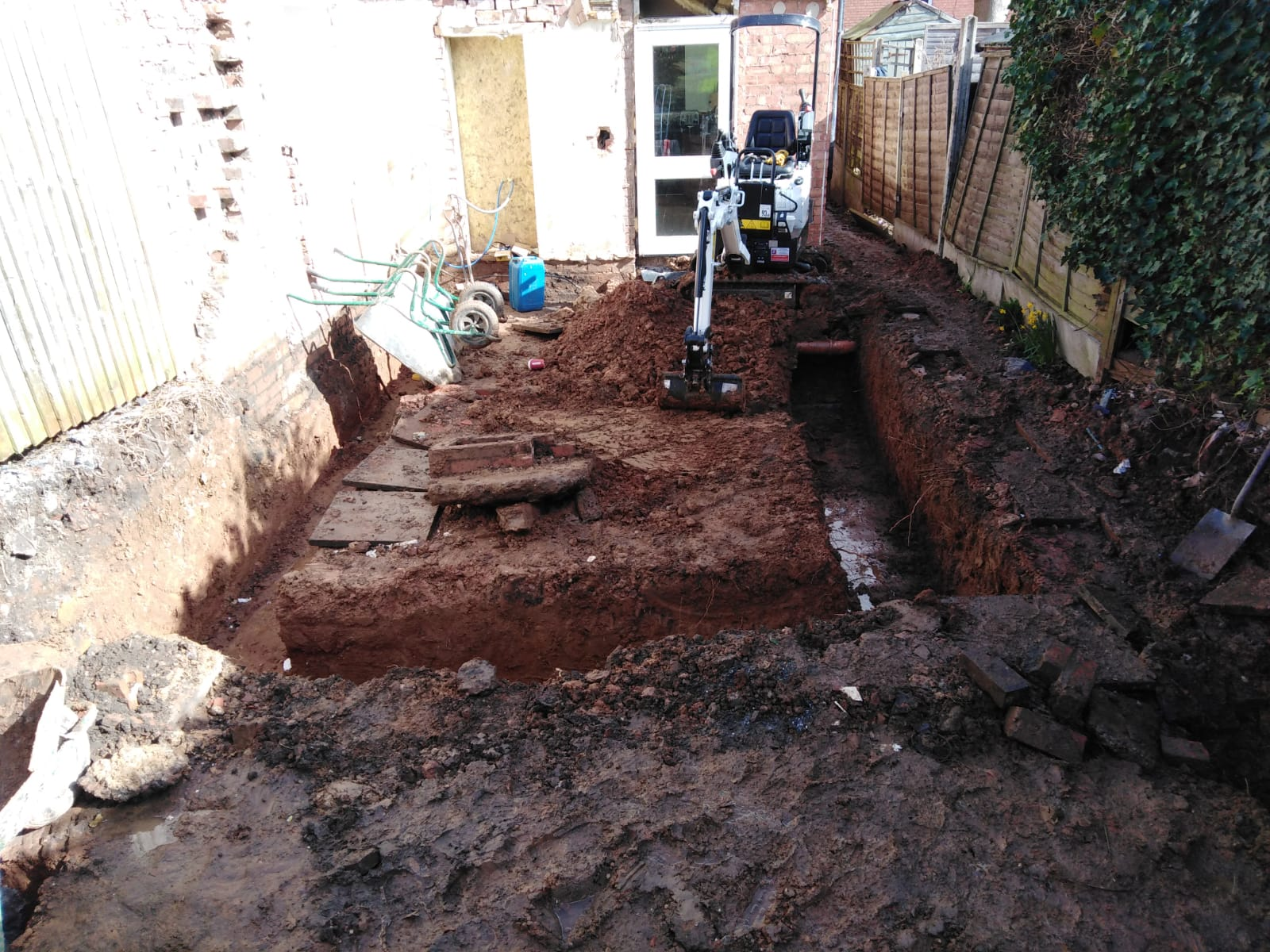Micro digger excavating footings in Stirchley, Birmingham B30.